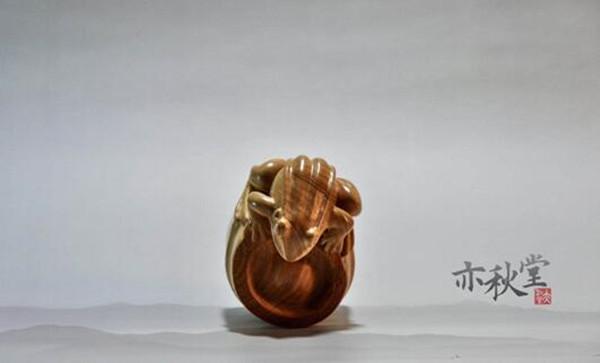 亦秋堂的崖柏雕刻作品《攀》